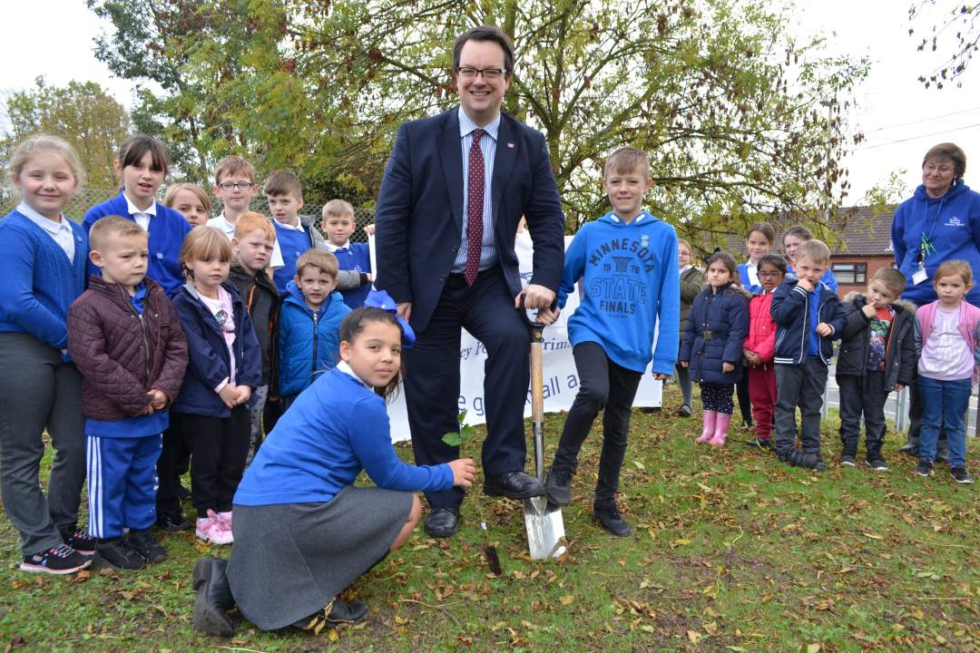 Mike joins children and staff at Bromley Pensnett Primary School to plant trees he received from the Queen's Commonwealth Canopy